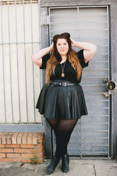 nataliemeansnice:  leather meets femme, photo by shainasheaffphoto. -top by images+ -skirt by posh shoppe (iheart poshshoppe.com) -boots by forever21