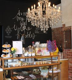 chandelier, exposed brick, blackboard, cakes....what's not to love?