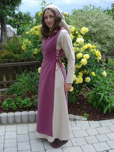 Middle Ages Dress by ~HEXEnART on deviantART don't really like it i think it's a dress for peasants...but the flowers in that background are nice in the back.