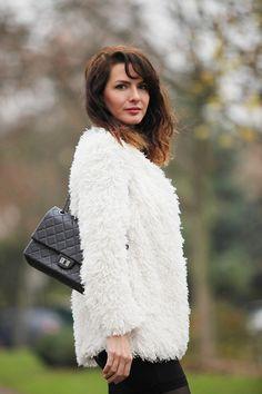 Fake fur coat, Chanel 2.55 bag / clutch, little black dress
