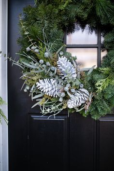 With whites and greens, amid glistening ornaments, this trimming set will create a festive doorway in no time! The Silver Evergreen Frost uses cedar, silver fir, eucalyptus, white sticks, birch poles and white cones for a stunning Christmas front door.  Designed and made at West Coast Gardens for the Christmas season.  Trimming Sets at West Coast Gardens  www.westcoastgardens.ca  #garland #cedargarland #patiodecor Christmas Front Doors, Christmas Wreaths, Winter Container Gardening, Front Door Plants, Silver Fir, Willow Wreath, Winter Plants, Natural Christmas, Old Fashioned Christmas