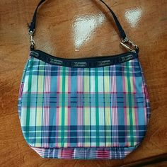 Small LeSportsac purse. Some ink stains on interior that I haven't tried to remove myself. Price reflects minor damage. LeSportsac Bags Mini Bags