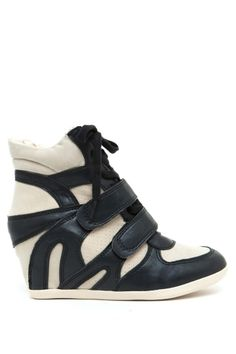 Rock these covered wedge sneakers with everything from dresses to basic jeans and tee outfits. PU and faux-suede body. Lace up front. Velcro straps.