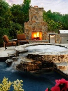mint hot tub with outdoor fireplace!  poolandspa.com
