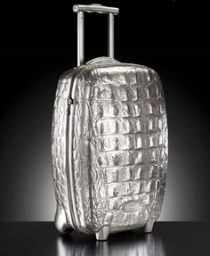 /\ /\ . Alexander McQueen's Hero suitcase for Samsonite, 2007. Recently reissued in silver, with a thermoformable, impact-resistant paint developed by Bayer for the auto industry.