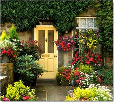 Floral welcome ~ A cottage in the village of Grassington, North Yorkshire, UK.