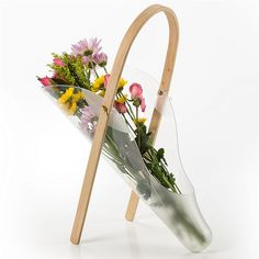 Like a basket, but better! This flower carrier holds water, so flowers stay fresh while you continue your work in your yard.