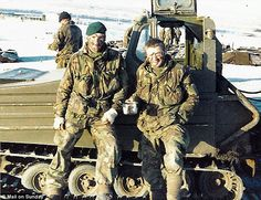Mr Taylor, left, sporting the commandos' famous green beret during the war
