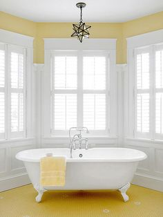 It's easy to start everyday with a smile when you have a bright yellow bathroom to get ready in.