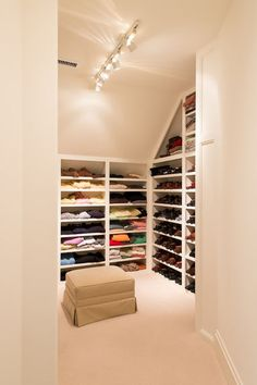 Consider open shelves. If your space is fairly tight, open shelving prevents swinging doors that may end up getting the way. Paint your space a light neutral so that colorful visible clothing feels complementary to the aesthetic instead of clashing with a bold room color