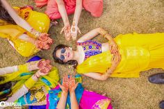 Bride with Bridesmaids Showing Off Mehendi