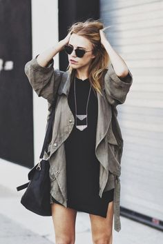 Cargo jacket | Black dress | Loose hair | Sunglasses and Triangle necklaces
