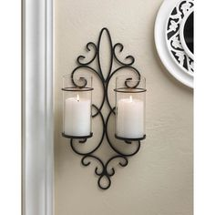 Chippendale Stylish Candle Wall Sconce features a beautiful iron wall sconce with two clear hurricane lanterns This beautiful wall sconce display traditional candlelight from any wall within your home