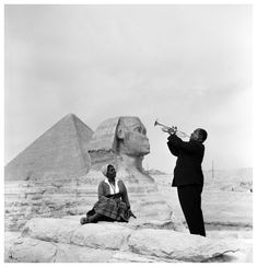 Louis Armstrong playing for his wife Lucille in front of the Sphinx in Egypt during his tour of Egypt as a jazz ambassador to promote the United States, 1961 [1233 × 1280] - Imgur