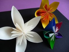 Origami Flowers - very simple to make and look very pretty - I'll be making many of these for floral arrangements in the house.