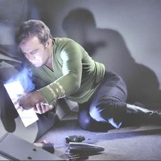 Jim Kirk, proving he's not all ripped shirts and dashing looks and command decisions. When needs must, he can get down on the floor like the rest of them and put the ship back together with his bare hands. You go, Jim. << YEP.