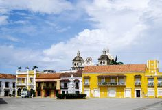 Cartagena is one of Colombia's most popular tourist destinations thanks to its interesting history, excellent cuisine, and amazing shopping. Cost Of Living, Amazing Shopping, Interesting History, Things To Do, Royalty, Mansions, Live, House Styles, Cartagena Colombia