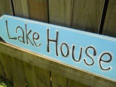 Distressed vintage style lake house sign