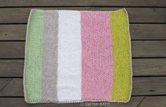 Tutorial to make a cute, cuddly, handmade baby blanket in just 10 days. Yarn stash busting projects. Handmade knits for your family.