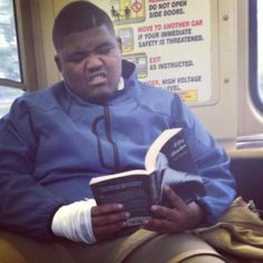 This picture of a guy reading 50 Shades of Grey in public is priceless