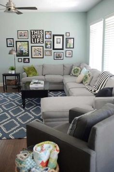 Over the Couch Display and I love the rolled up quilts in the basket!!!