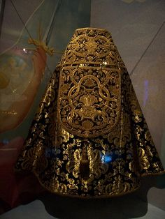 Vestments  The back was more decorated than those of today because the priest would face the altar as he performed the service. This black cope is for funerals. It is still in use today.
