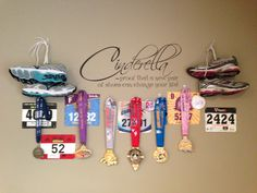 My display of my race medals and bibs. I put it by my treadmill for inspiration! AF  I love the idea of hanging up the shoes!