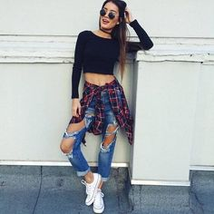 26 Great Fall Outfits: Ideas To Try Already This Autumn/Winter Season: Woman wearing ripped blue jeans, black crop top, plaid shirt and white Converse sneakers