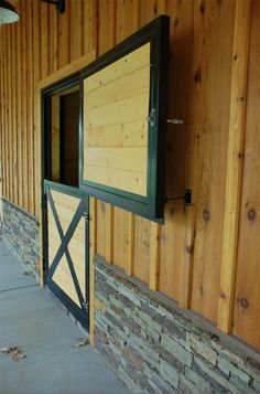 Dutch doors on the exterior of the barn with wood and stone details