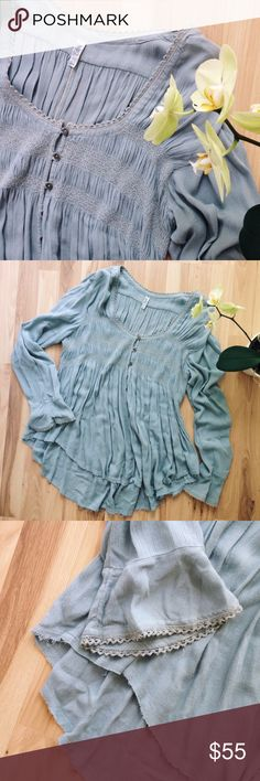 """Free People Blue-Grey Peasant Blouse Blue-grey, button-down peasant blouse. Hi-low, raw bottom hem. 100% rayon. Approximately 18.5"""" bust, laid flat, 27/30"""" long, and 26.5"""" sleeves. Free People Tops Blouses"""