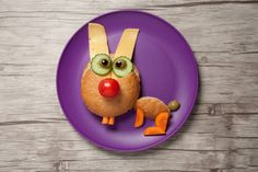 funny hare made of bread cheese and vegetables on plate and table
