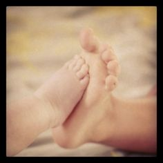 Brothers foot picture-- HAHA Zeke would love this! He is so obsessed with feet.