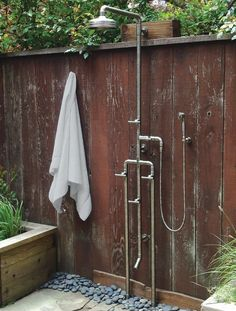 sonoma-forge-outdoor-shower-with-foot-shower  ~ Great pin! For Oahu architectural design visit http://ownerbuiltdesign.com