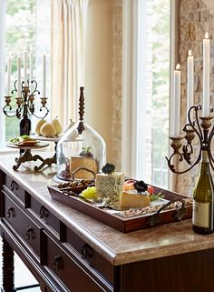 An enticing buffet. Hors d'oeuvres are even more irresistible when presented on upscale serveware. Like these Reclaimed Cheese Domes, these Mesetta Tiered Servers, the Porto Wine Candelabra, and a Tuscan Cheese Serving Tray... Simply perfect!