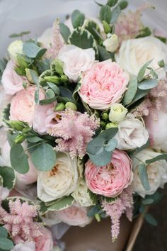Wedding bouquet in blush pink tones. The bouquet includes Mansfield Park roses, Ohara roses, eustoma, astible, pitto and eucalyptus foliage. Liberty Blooms
