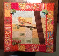 Always With You - Quilted wallhanging for my mom.  The bird is symbolic of my father watching from above. The nine flowers symbolized the nine children in my family.