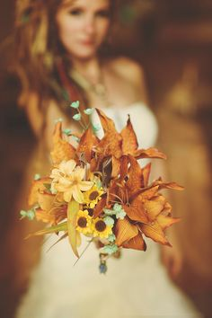 The ultimate autumn bouquet... Love the little blue flowers in there for contrast