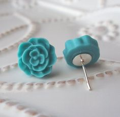 I have a lot of these posts lying around.  I suppose that I could make anything out of polymer clay and attach them to the posts.