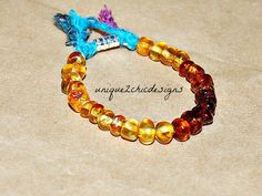 Rainbow Baltic Amber Teething by uniQue2ChicDesigns on Etsy