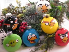 Angry Birds Ornaments ... Originally on Etsy (but gone right now).  This looks like an easy DIY project if you have a few drawing/painting skills.