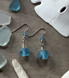 Simple elegant tropical ocean water Periwinkle blue Sea Glass beads with rough silver metal beads and metal fishhook ear wires. Handmade here at Sea Things, Ventura, CA Materials: Mixed Metal and Recy