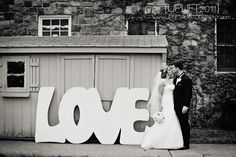 Our photographer just happened to find this awesome LOVE sign laying around at our venue!