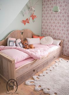 Really like the real wood day bed, comfy bedding, textured rug, and butterflies on the wall, wall paper and even the little stuffed deer.