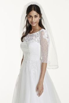 David's: You'll be a vision in white (or ivory) in this tulle ball gown with a lace illusion bodice. This lovely dress has 45 expertly detailed yards of fabric with lace appliques, boatneck, three-quarter sleeves, and a sweep train.  Sample Sale gowns are only available online (not available in stores).  Sample Sale gowns contain imperfections such as tears in the lining or tulle, or imperfect seams in the skirt, etc.  Specific imperfections are not visible in the photograph shown which is