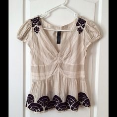 Anthropologie Blouse Deep v-neck blouse by Lithe from Anthropologie. Side zipper, light beige with dark purple embroidery, size 6, 100% cotton. Anthropologie Tops Blouses