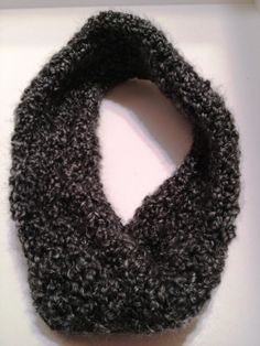 "Your neck will be nice and warm this winter with this trendy, grey, infinity scarf. Crochet with a soft acrylic yarn. Double thickness. This scarf was made with a ""twist"" in it.Measures 3.5"" x 26""."