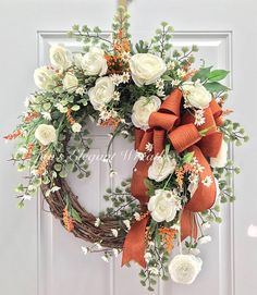 Can I compare thee to a summers day? No, Im not into poetry. :-) But, that is what comes to mind when I look at this wreath. Airy and warm. Beautiful and elegant. Delicate white ranunculus blooms with lots of white filler flowers and orange heather cover this beautiful wreath. A