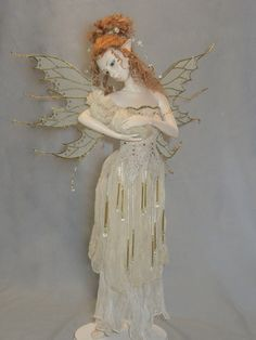 Tenderness by Hannie Sarris is sculpted from Premier clay. She is 45 cm tall - 19 inches. Clothes from silk, organza, beads. Hair is made of mohair. She has painted eyes.