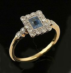 An Art Deco sapphire and diamond plaque ring, the square panel