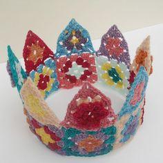 What a fun little idea!! Crochet mini granny square and triangle crown. Crochet crownbytintocktapfound via Flickr.